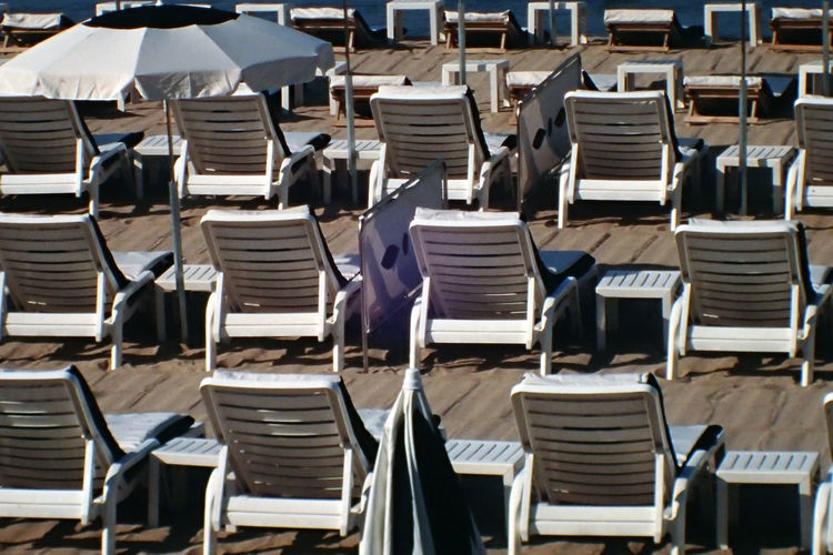 Lounge chairs arranged at beach