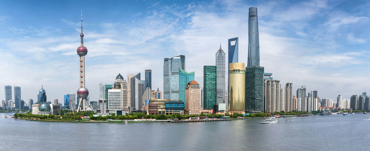 Panoramic view of the modern skyline of Pudong in Shanghai, China Shanghai Skyscrapers Tourist Attraction  Travel Architecture Building Built Structure China City Cityscape Cloud - Sky Financial District  Landscape Modern Office Pudong Sky Skyscraper Tall - High Tourism Tower Travel Travel Destinations Urban Skyline Water