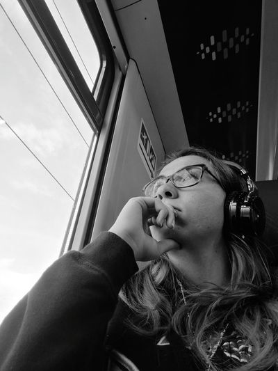 Look deep into nature, and then you will understand everything better. Albert Einstein Music Music Is My Life Headphones Window Look Look Outside Look Out Look Out The Window Blackandwhite Pensive Pensive Train Tranquility Travel Traveling Tra Young Women Beautiful Woman Headshot Close-up Pensive Wearing Thinking Head And Shoulders Glasses Attractive
