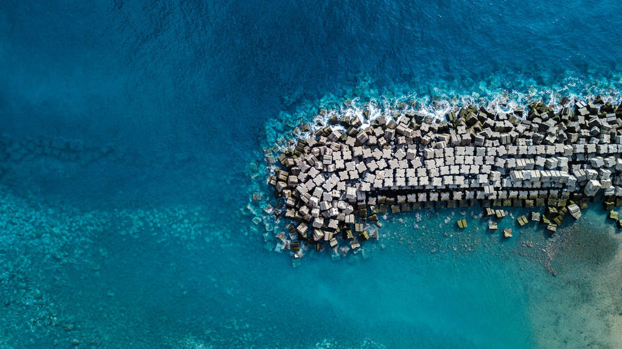 drone top view of concrete tetrapods on water Drone  DJI Mavic Pro DJI X Eyeem Tetrapod Water Sea Ocean Top View Top Perspective High Angle View Above Directly Above Turquoise Colored Turquoise Water Protection Scenics Harbor Abundance Aerial View Pattern Textured