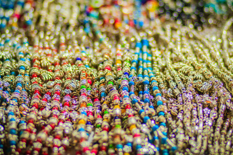 Colorful bracelets, beads and necklaces souvenir for sale on street at Khao San Road night market, Bangkok, Thailand. Bracelets Khao San Rd Khao San Road KhaoSan Khaosan Rd. Khaosandroad Necklaces Tourist Tourist Attraction  Tourists Abundance Art And Craft Backgrounds Bracelet Choice Close-up Day For Sale Full Frame Indoors  Jewelry Khao San Khao San Knok Wua Khao San Rd. Khaosan Road Khaosanroad Large Group Of Objects Multi Colored Night Market Night Market In Thailand Night Market, No People Ornate Pattern Selective Focus Still Life Temptation Tourist Destination Variation