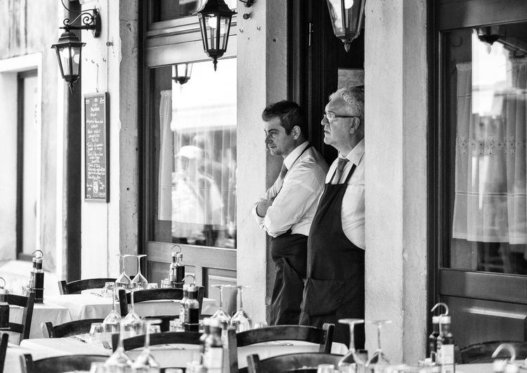 Streetphotography Street Photography Black & White Venice Venezia Restaurant Waiter Real People One Person Women Standing Lifestyles Adult Leisure Activity Three Quarter Length Day
