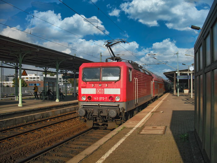Train on railroad station platform against sky