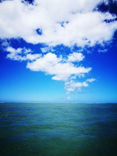 Blue Sky Sea Sky Blue No People Calm Sea Lagoon Beauty In Nature Calm Nature Clouds Beautiful Weather♡ Peaceful Middle Of The Sea