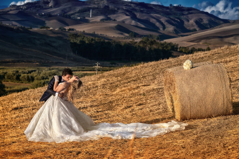 Adult Bride Celebration Couple - Relationship Emotion Environment Land Landscape Love Mountain Nature Newlywed Outdoors People Positive Emotion Two People Wedding Wedding Dress Women Young Adult