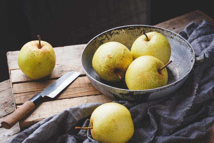 Fresh Asian pears ASIA Asian Pear Diet Eating Raw Vietnam Art Delicious Fabric Food Food And Drink Freshness Fruit Healthy Eating Healthy Food Healthy Lifestyle Indoors  Old Wood Organic Pear Still Life Sweet Sweet Food Tasty Vitamin