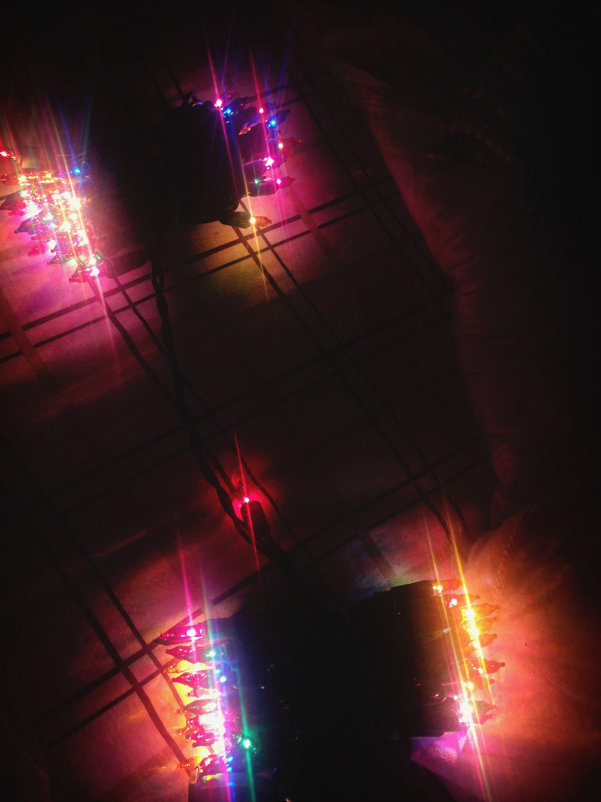 illuminated, night, lighting equipment, glowing, low angle view, light - natural phenomenon, indoors, electric light, light, decoration, electricity, built structure, dark, lit, architecture, light beam, celebration, ceiling, hanging, multi colored
