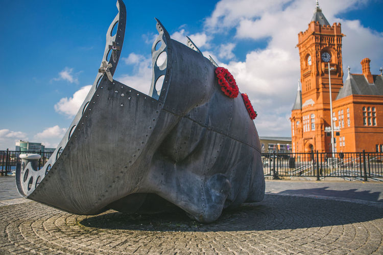 Merchant Seafarers' War Memorial in Cardiff Bay, in South Wales, UK. Architecture Brian Fell Built Structure Cardiff Bay Cardiff Bay Wales Half Face, Half Hull Memorial Sculpture Merchant Seafarers' War Memorial Pierhead Building Travel Destinations Wales
