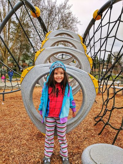 Portrait of smiling girl playing in playground