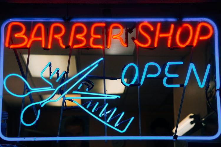 Close-up of illuminated neon sign