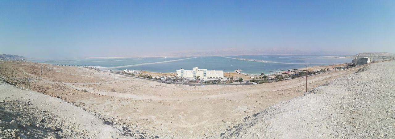 Scenic View Of Desert By Dead Sea Against Sky