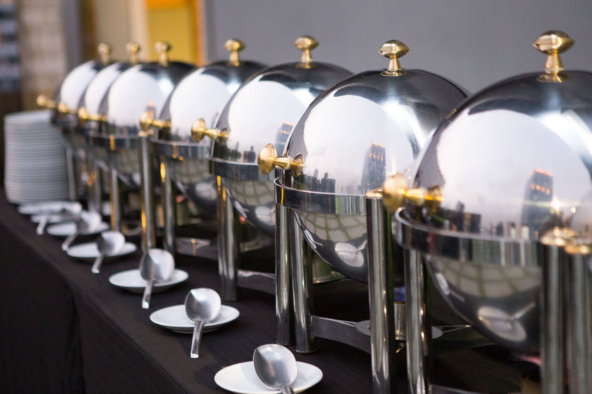 Chafing dishes on the table at the luxury banquet In A Row Metal No People Lighting Equipment Arrangement Selective Focus Order Large Group Of Objects Close-up Indoors  Illuminated Food And Drink Industry Business Side By Side Restaurant Chafing Dish Luxury Banquet