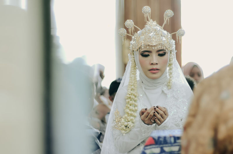 Close-up of bride during wedding ceremony