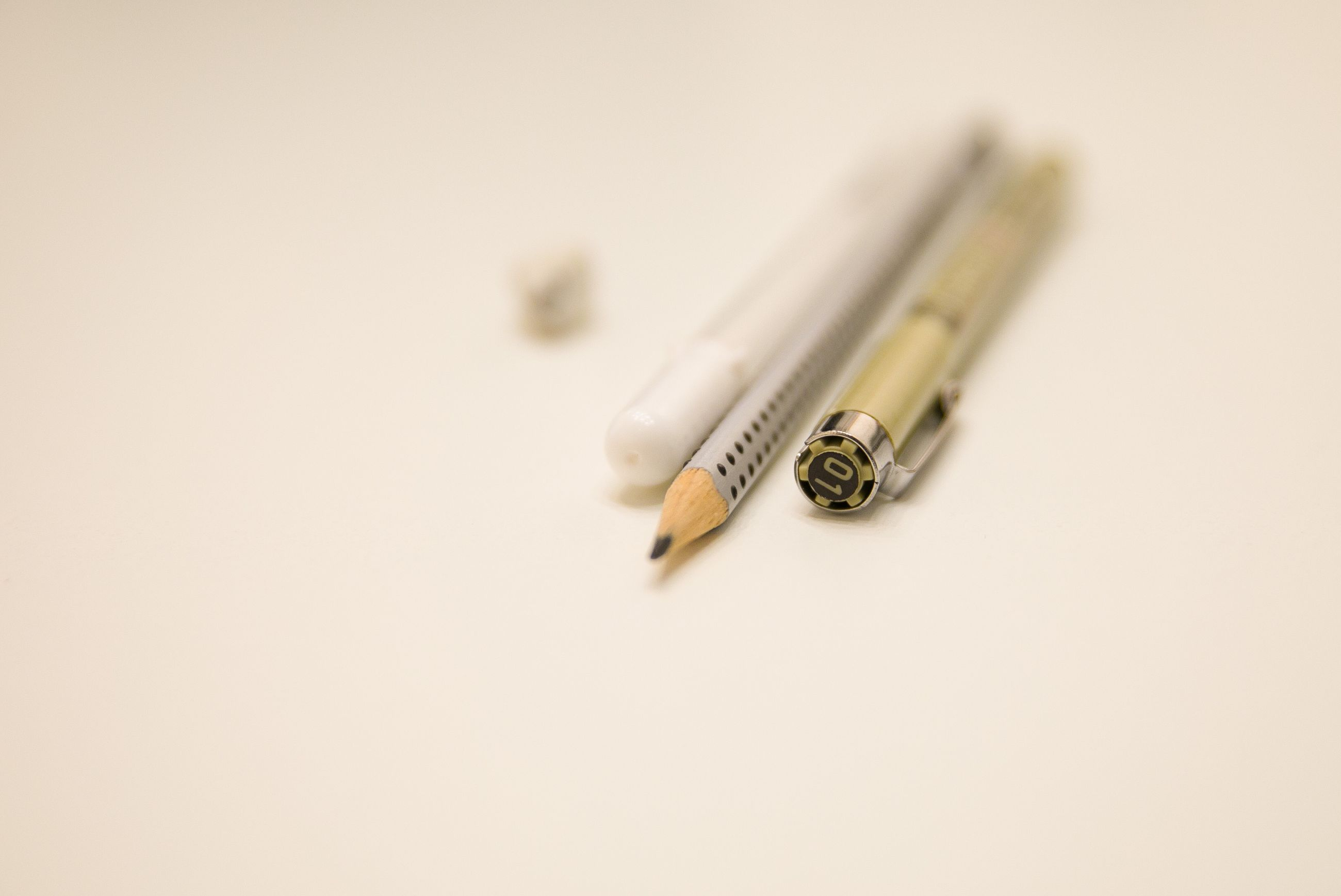 studio shot, still life, indoors, copy space, no people, close-up, white background, high angle view, selective focus, focus on foreground, white color, pencil, communication, warning sign, writing instrument, cut out, sign, healthcare and medicine, cigarette, single object