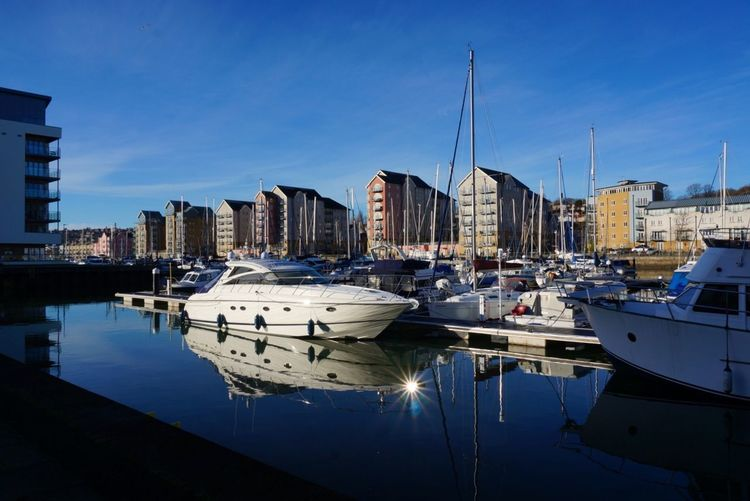 Sunflare 500px Landscape Reflections In The Water Reflections Ladyphotograferofthemonth Shootermag England Portishead Moored Water Harbor Mode Of Transport Reflection Transportation Boat Marina Yacht Sailboat Waterfront Architecture Building Exterior The Graphic City Stories From The City The Street Photographer - 2018 EyeEm Awards The Architect - 2018 EyeEm Awards #urbanana: The Urban Playground