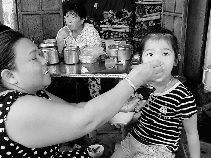 Eating Food And Drink Food Market Vietnamesegirl Feeding Baby