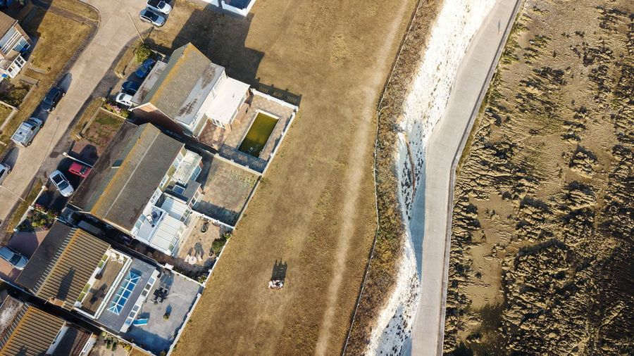 over cliffs Cliffs white cliffs Dronephotography Homes Seavew Peacehaven, Eastbourne, East Sussex. UK. Cliffs White Cliffs  Summer Walks EyeEm Best Shots England, UK Liverpool EyeEm Selects High Angle View Sunlight Architecture Building Exterior Residential District Residential Building
