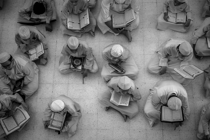 Top Down view - Muslim Students reading the Quran. Abundance Arrangement Backgrounds Black And White Book Close-up Full Frame In A Row Islam Kids Koran Muslim Pattern Quran Reading Religion Repetition Side By Side Students Top Down Variation