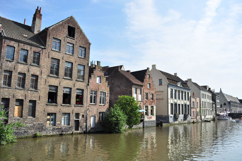 Architecture Blue Building Exterior Built Structure Canal City City Life Cityscapes Day Gent Gentse Feesten Ghent Ghentstagram Graslei No People Old Buildings Open Window Outdoors Sky Tourism Water Water Reflections Waterfront