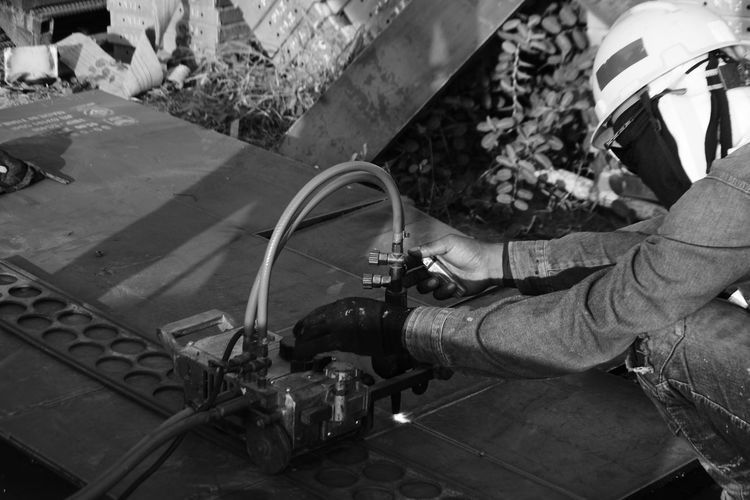 High angle view of worker with equipment