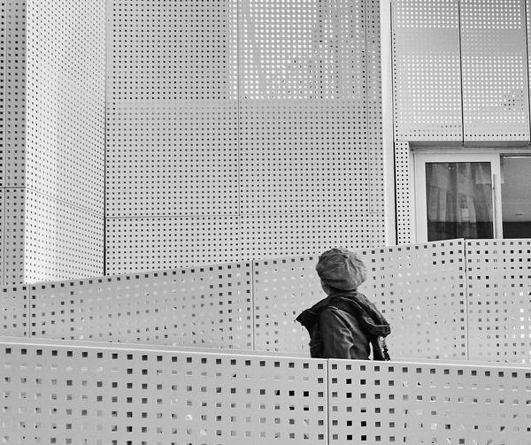 Person in urban architectural building