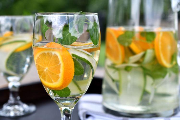 Infused spa water - cucumber slices, oranges and orange mint in water. Cucumbers Detox Drink More Water Hydration SPA Water Serving Drinks Cucumber Water Dehydration Detoxwater Drink Drinking Glass Drinks On A Tray Food And Drink Fruit In Water Health Spa Healthy Healthy Drinks Healthy Eating Healthy Lifestyle Infused Water Mint Oranges Refreshment Spa Water The Still Life Photographer - 2018 EyeEm Awards