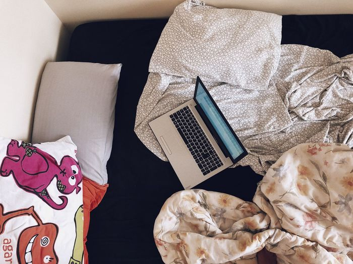 Relaxing with a movie on the bed Sheets Bed Relax Movıe Computer Indoors  High Angle View Still Life No People Art And Craft Table Relaxation