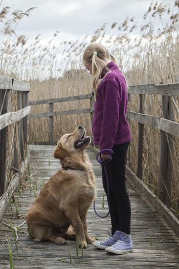 Girl with dog outdoors