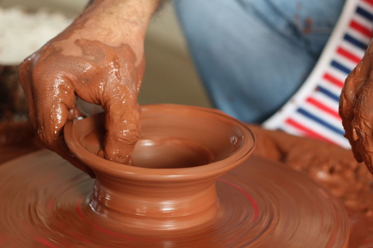 Cropped Hand Of Potter Working In Pottery Workshop