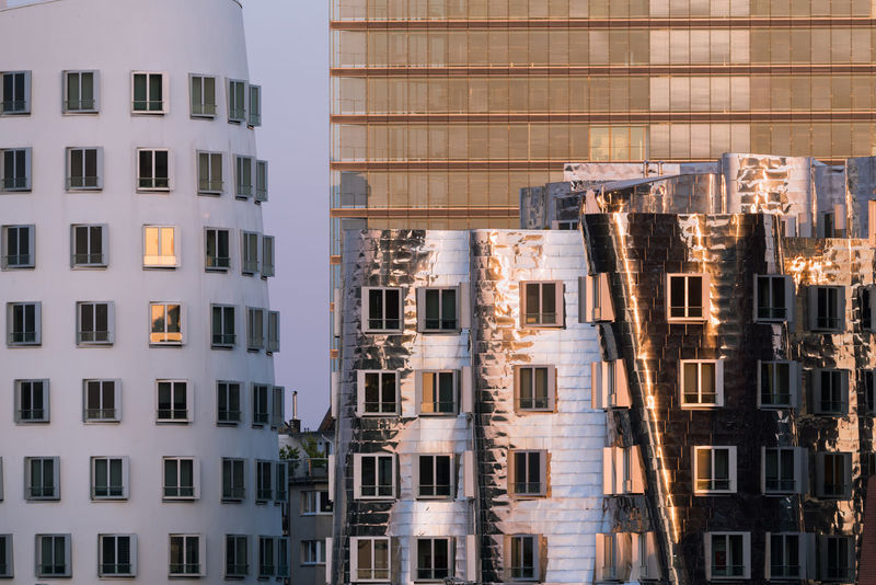 DUESSELDORF, GERMANY - SEPTEMBER 14, 2016: Modern facades in the media harbor reflect the sunset. Apartment Architecture Architecture Attraction Building Exterior Business Finance And Industry City Cityscape Düsseldorf Germany M Medienhafen Modern New Media Harbor No People People Place To Be  Scenics Ship Skyscraper Tourism Urban Urban Geometry Urban Skyline Water