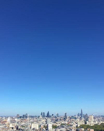 Cityscape against blue sky