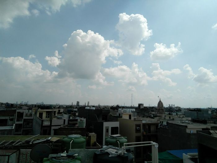 Clouds Cloud - Sky High Angle View Sky No People Architecture Urban Skyline City Cityscape Outdoors Day Building Exterior Architecture Building Terrace Buildings And Sky Dense Clouds Densely Populated Skyscraper