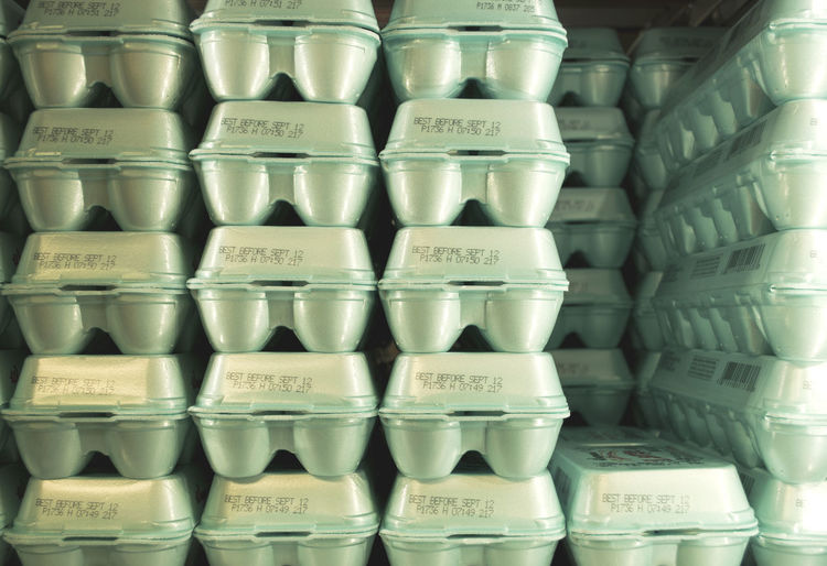 Full frame shot of stacked polystyrene egg cartons