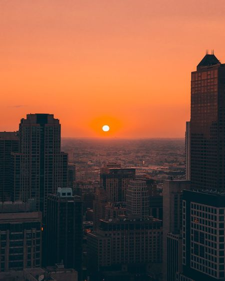 EyeEm Selects Sunset Skyscraper Cityscape Architecture Orange Color Building Exterior City Sun Built Structure Modern No People Travel Destinations Sky Growth Tall Urban Skyline Outdoors Nature
