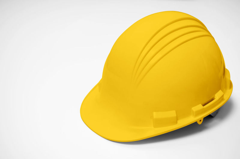 Yellow helmet isolated. on white background, Yellow hat For Labourers and Earth Moving Operators. Helmet Hat Safety Top View Isolated Hard Yellow White Background Construction Engineer Cap Worker Equipment Builder Protect HEAD Job Tool Plastic Build Headgear Color Blue Hardhat  Protection Protective Object Industry Industrial Safe Danger Wear Solid Work Isolate Workman Overhead Contractor Engineering Architecture Above ARCHITECT Front