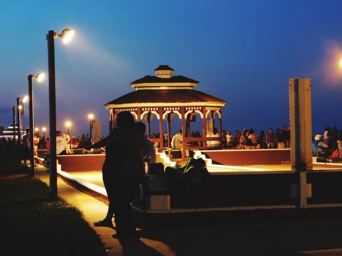 Illuminated Rear View Lifestyles Women Walking Outdoors Night Built Structure Street Light People