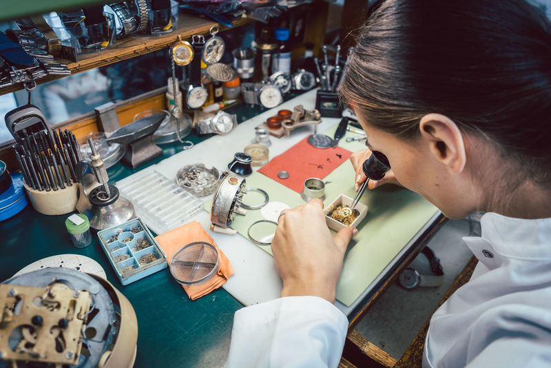 Diligent watchmaker working on watch looking thru optical piece on small components Attention Repairing Small Business Wheel Woman Work Working Workshop Accuracy Attention To Detail Clockwork Close-up Detail Diligence Diligent Enjoying Life Gear Occupation Watch Watchmaker