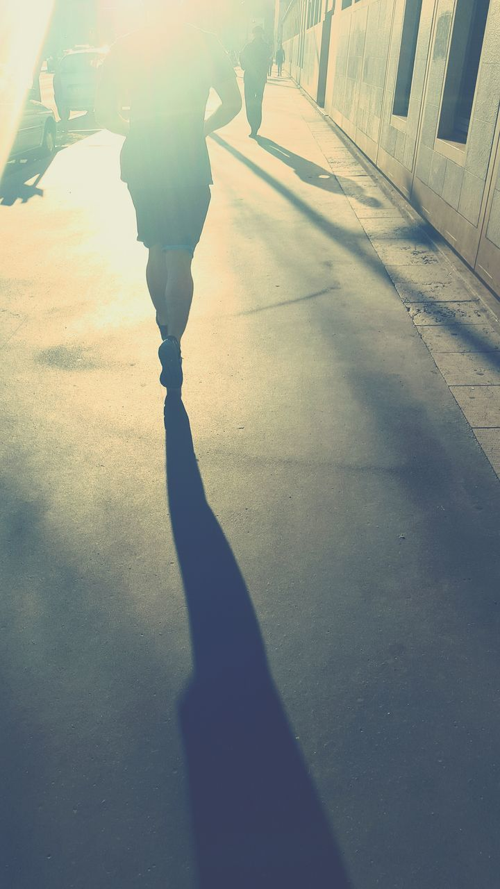 low section, real people, shadow, human leg, one person, human body part, sunlight, outdoors, day, lifestyles, human hand, close-up, people