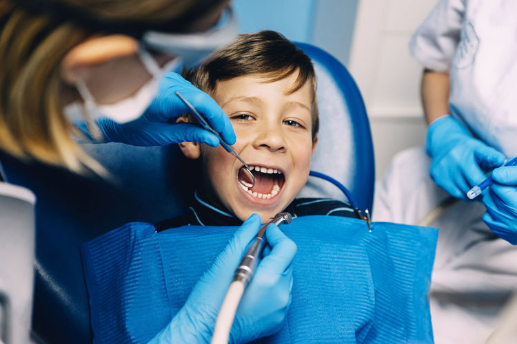 Dentists with a patient the dental Concept Dental Dentist Dentistry Diagnosis Doctor  Hospital Medicine Uniform Boy Child Clinic Clinical Equipmet Expertise Health Care Job Kid Mask Medical Odontology Professional Technology Teeth Tooth Treatment