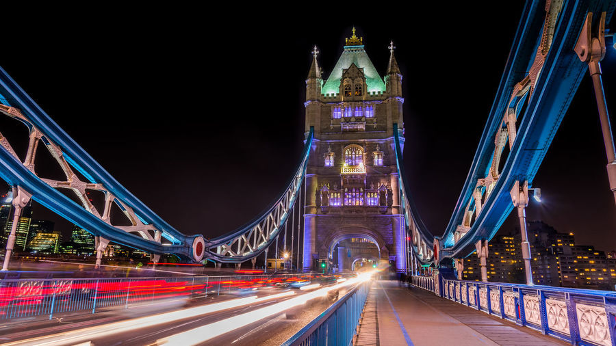 Light trails on tower bridge against clear sky at night