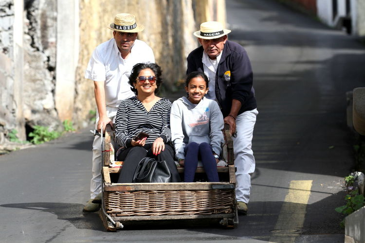 Monte Toboggan Ride - Photo of the famous toboggan ride on the Monte slopes of Madeira, Portugal. Originally a fast means of transport down to Funchal for people living in Monte, these toboggan sledges appeared around 1850 Casual Clothing Downhill Front View Fun Ride Leisure Activity Madeira Monte Portugal Street Photography Streetphotography The Street Photographer - 2016 EyeEm Awards Toboggan Toboggan Ride Transportation Madeira, Portugal Funchal Need For Speed