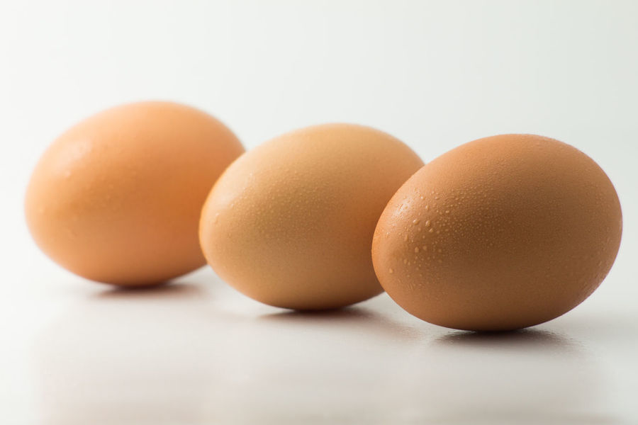 The Eggs in row. Animal Egg Breakfast Chicken Close Up Cool Dinner Eggs Food Lunch Selective Focus Studio Shot Three White Background