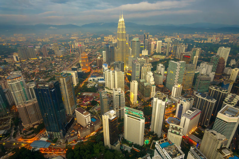 High angle view of petronas towers in illuminated city
