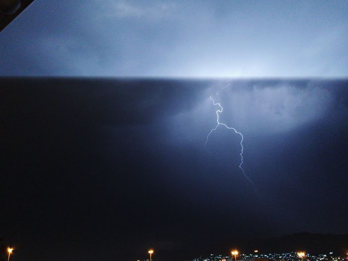 Night Lightning Storm Illuminated Sky Cloud - Sky Power In Nature Nature Beauty In Nature Thunderstorm No People Warning Sign Outdoors Storm Cloud Power Wet Communication Sign Forked Lightning Rain
