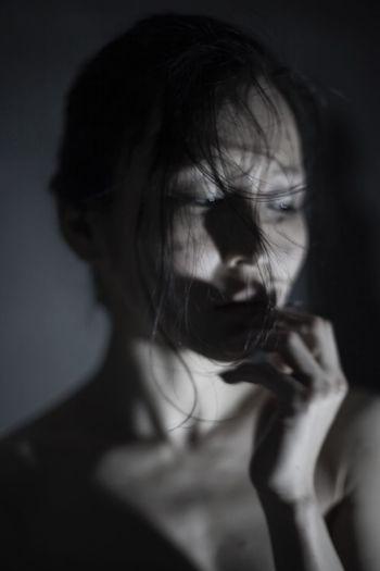 Defocused image of woman in darkroom