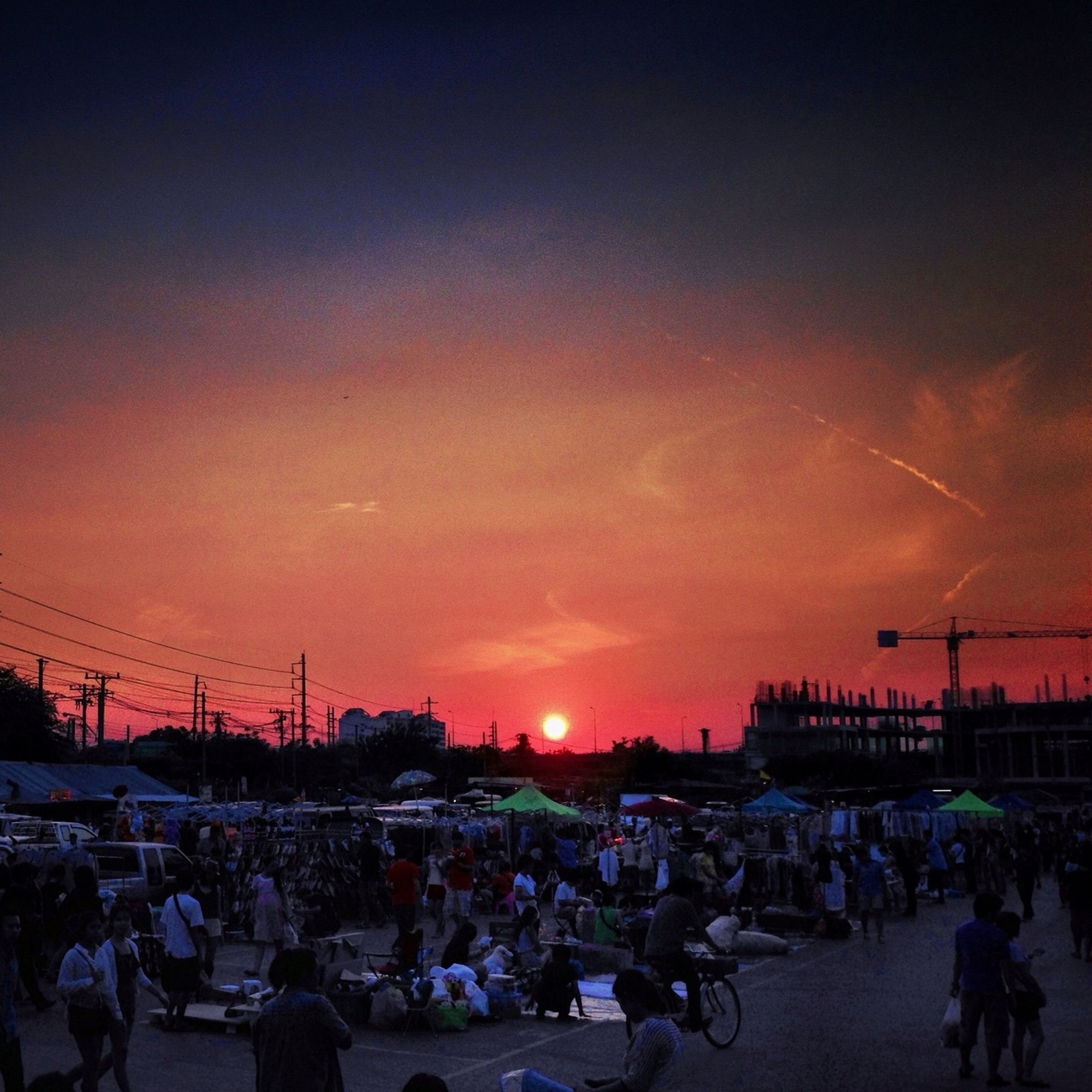 sunset, large group of people, sky, car, transportation, building exterior, street, crowd, mode of transport, land vehicle, silhouette, built structure, city, cloud - sky, architecture, outdoors, city life, dusk, men