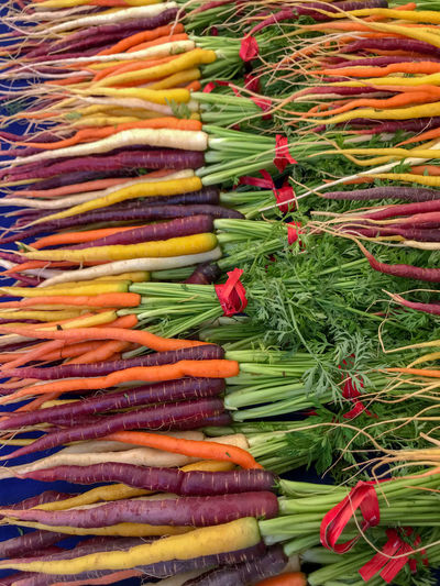 Farmers Market Fresh Produce Nature Abundance Backgrounds Carrot Choice Food For Sale Freshness Full Frame Healthy Eating High Angle View Large Group Of Objects Market Multi Colored No People Organic Retail  Retail Display Root Vegetable Sale Variation Vegetable Wellbeing