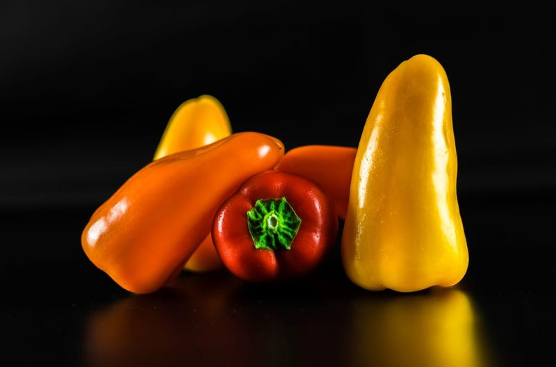 Baby pepper team Baby Pepper In Pepper Close-up Cool Lighting Food Freshness Healthy Eating Indoors  Orange Peppers Red Studio Shot Vibrant Color Yellow