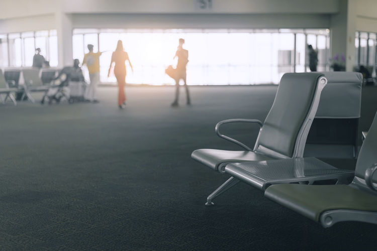 Side view of people at airport