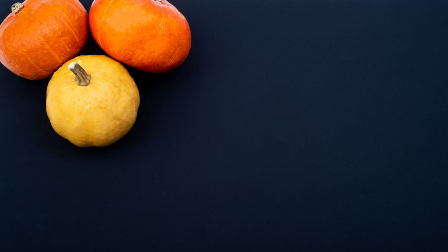 High angle view of oranges on table against black background